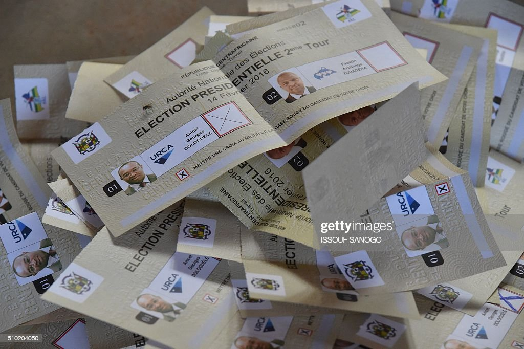 Counted votes are seen after polls closed following the second round presidential and legislatives elections in Bangui, on February 14, 2016. The Central African Republic held delayed presidential and parliamentary polls on February 14, with voters desperate to usher in peace after the country's worst sectarian violence since independence in 1960. / AFP / ISSOUF SANOGO