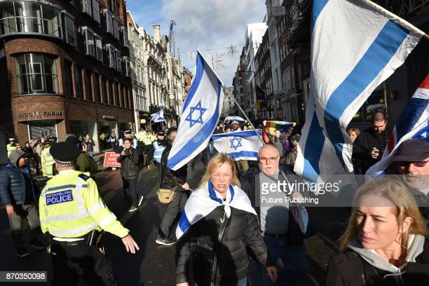 A counter demonstration by a Jewish group walks in front of the Palestinian marchers through central London on November 04 2017 in London England...