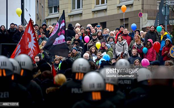 Counter demonstrators of HoGeSa and Salafi supporters gather on March 14 2015 in Wuppertal Germany Several hundred Salafis who in Germany are...