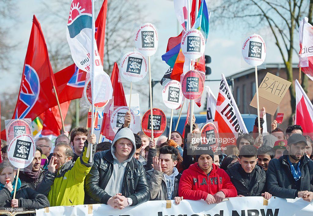 Counter demonstrators stand at a barrer after a protester hit Joerg Ueckermann, Deputy Chairman of the anti-Islam Pro-NRW group, in the face with an egg while Ueckermann was speaking during a Pro-NRW rally on March 18, 2013 in Bielefeld, Germany. Nine Pro-NRW members held the rally and were booed down by 700 counter-demonstrators. Pro-NRW, based primarily in western Germany and Berlin, has sought a strongly anti-Islam agenda and demonstrates frequently against the construction of mosques in Germany. Police recently arrested several radical Salafite Islam members in Germany who were planning to assassinate Pro-NRW leader Markus Beisicht.