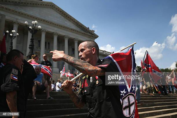 Counter protesters and Ku Klux Klan members argue at a Klan demonstration at the state house building on July 18 2015 in Columbia South Carolina The...