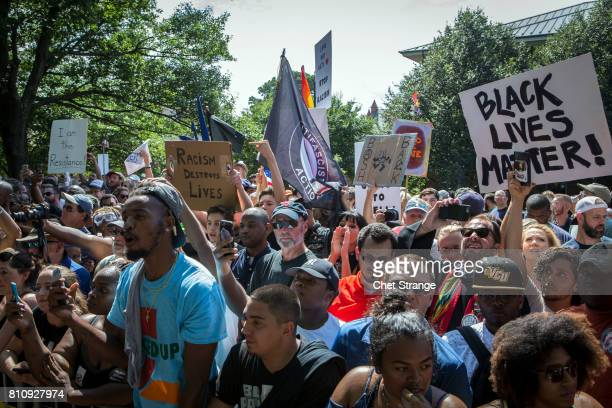 Counter protestors gather during a planned Ku Klux Klan protest on July 8 2017 in Charlottesville Virginia The KKK is protesting the planned removal...