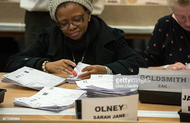 A counter sorts ballot papers at the Richmond Park byelection count at Richmond Upon Thames College on December 2 2016 in London England Zac...