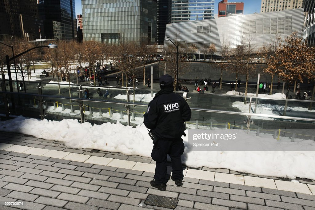 A counter terrorism officer stands in front of One World Trade Center at ground zero in Manhattan on March 20, 2017 in New York City. Senate Minority Leader Chuck Schumer has been voicing criticism of President Donald Trump's proposed budget that could cut as much as $190 million from New York City efforts to fight terrorism. Following two major terrorist attacks and numerous foiled plots, New York City is considered the nation's prime target for terrorists. The NYPD has stated that it costs $500,000 a day to pay for the nearly 200 police officers in and around Trump Tower on Fifth Ave.