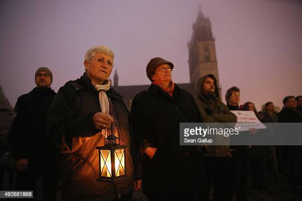 Counterdemonstrators attend a rally in favour of German Chancellor Angela Merkel's liberal policy towards taking in migrants and refugees during a...