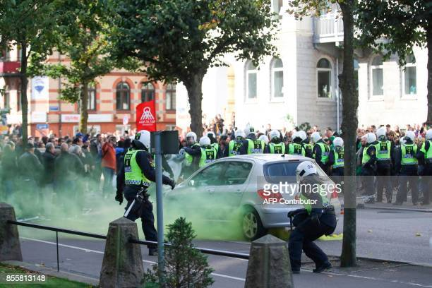 Counterdemonstrators protest in front of police officers prior to the farright Nordic Resistance Movement march in Gothenburg Sweden on September 30...
