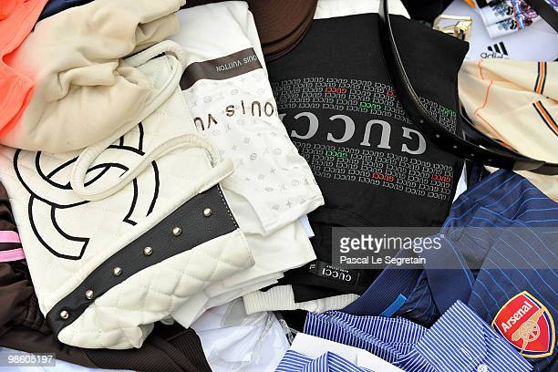 Counterfeit handbags and shirts seized by Customs are displayed at Ministere des Finances on April 22 2010 in Paris France France's Budget Minister...