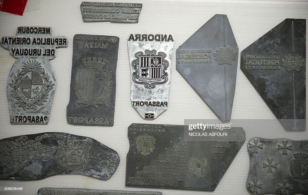 Counterfeit passport printing plates are displayed at the immigration bureau in Bangkok on February 10, 2016 after Thai police broke up a major fake passport ring led by an Iranian known as 'The Doctor' which sent thousands of passports to Middle Eastern customers trying to enter Europe. Five years of investigation culminated in the February 8 arrest of the alleged Iranian mastermind, 48-year-old Hamid Reza Jafary, police said. The kingdom has long been a hub for a forged document industry serving human traffickers and other criminals. AFP PHOTO / NICOLAS ASFOURI / AFP / NICOLAS ASFOURI