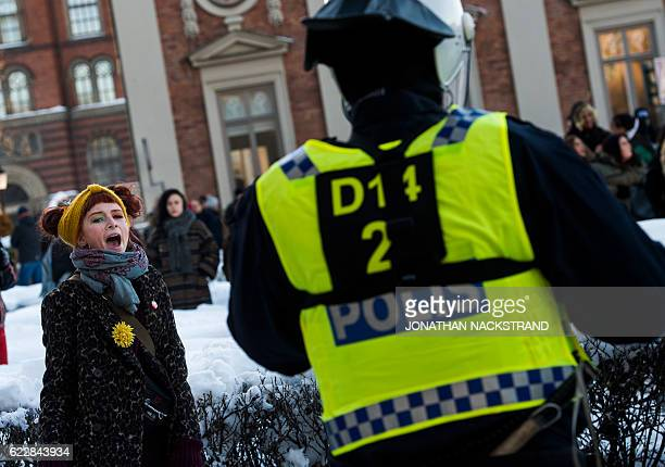 Counterprotesters demonstrate against the neonazi Nordic Resistance Movement 's rally in central Stockholm on November 12 2016 / AFP / JONATHAN...