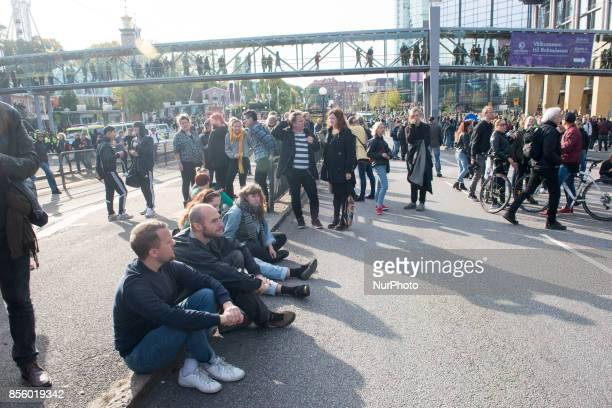 Counterprotesters take a break after clashing with police near the planned marching route of the Nordic Resistance Movement though central Gothenburg...