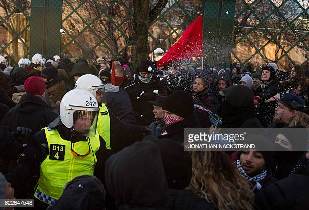 Counterprotesters throw snow balls on the police as they demonstrate against the neonazi Nordic Resistance Movement's rally in central Stockholm on...