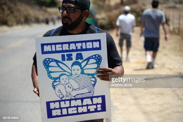 A counterprotestor holds a sign supporting immigration outside a US Border Patrol facility in Murrieta during an antiimmigration protest in Murrieta...