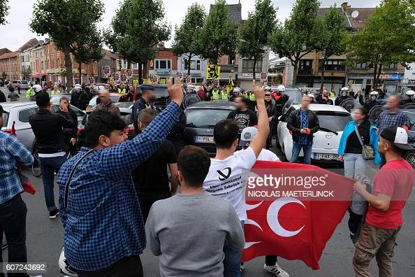 Counterprotestors are pictured during a demonstration of farright organisation Voorpost protesting against EU membership for Turkey on September 17...
