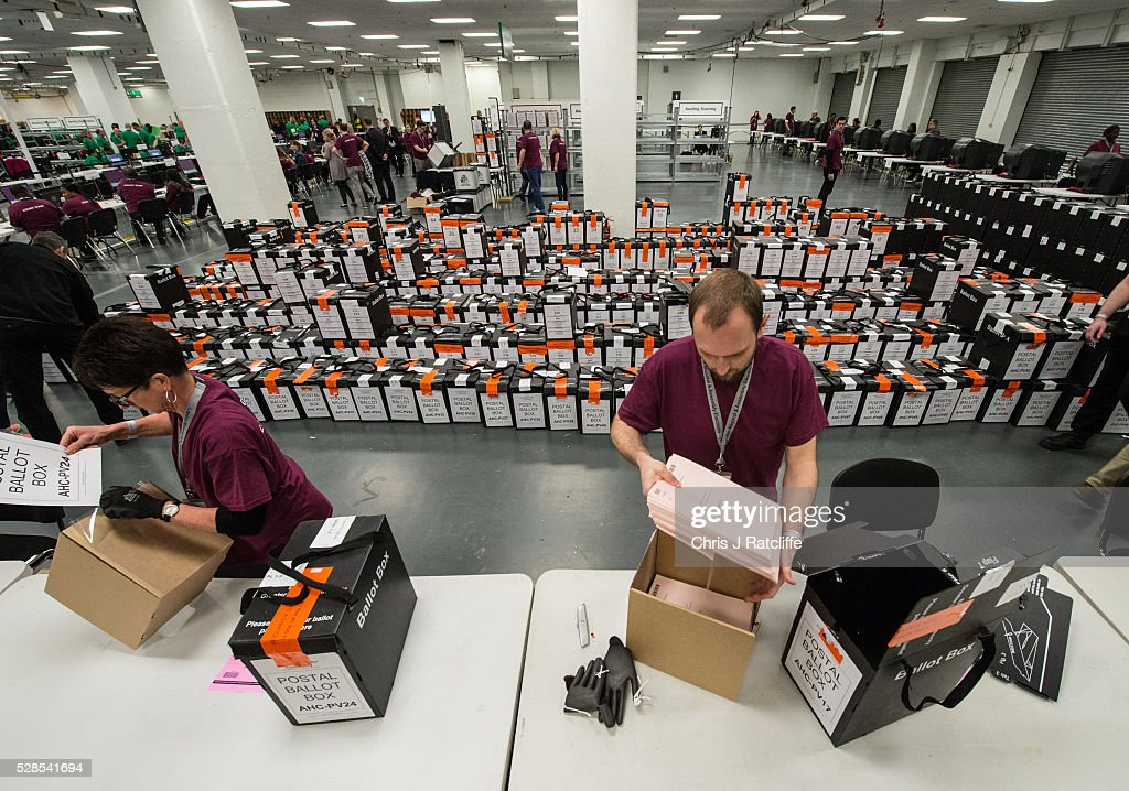 Counters open the first ballot boxes next to a stack of them during the London Mayoral and Assembly election count at Kensington Olympia on May 6, 2016 in London, England. This is the fifth mayoral election since the position was created in 2000. Previous London Mayors are Ken Livingstone for Labour and more recently Boris Johnson for the Conservatives. The main candidates for 2016 are Sadiq Khan, Labour, Zac Goldsmith, Conservative, Sian Berry, Green, Caroline Pidgeon, Liberal Democrat, George Galloway, Respect, Peter Whittle, UKIP and Sophie Walker, Wonmen's Equality Party.