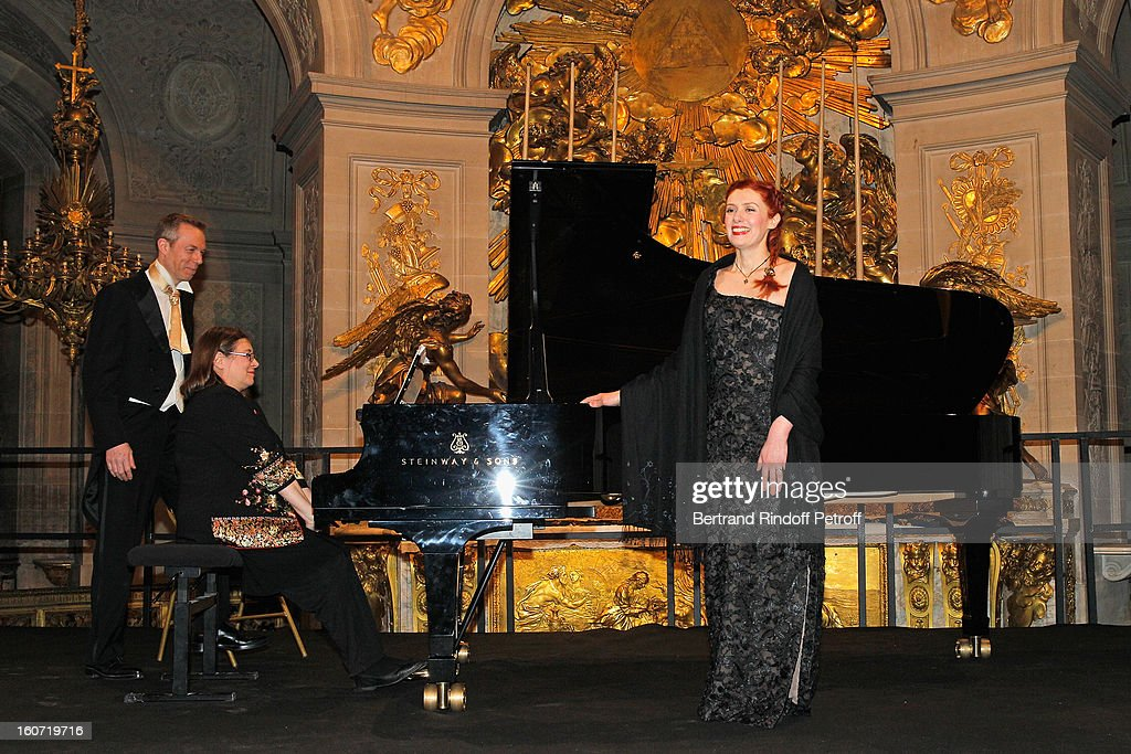 Countertenor Robert Expert, pianist Erika Guiomar and French coloratura soprano, Patricia Petibon acknowledge applause after they performed in the Royal Chapel prior to the gala dinner of Professor David Khayat's association 'AVEC', at Chateau de Versailles on February 4, 2013 in Versailles, France.