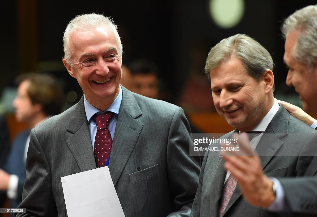 EU counter-terrorism chief <a gi-track='captionPersonalityLinkClicked' href=/galleries/search?phrase=Gilles+de+Kerchove&family=editorial&specificpeople=4505334 ng-click='$event.stopPropagation()'>Gilles de Kerchove</a> (L), European neighbourhood policy and enlargement negotiations commissioner Johannes Hahn (C) and EU migration, home affairs and citizenship commissioner Dimitris Avramopoulos talk on January 19, 2015 before the start of a EU Foreign Affairs Council meeting at EU headquarters in Brussels. EU foreign ministers are to discuss ways to boost anti-terror cooperation in the wake of the Paris attacks and the dismantling of a jihadist cell in Belgium.