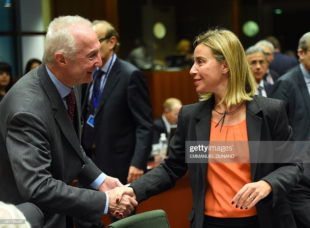 EU counter-terrorism chief <a gi-track='captionPersonalityLinkClicked' href=/galleries/search?phrase=Gilles+de+Kerchove&family=editorial&specificpeople=4505334 ng-click='$event.stopPropagation()'>Gilles de Kerchove</a> (L) shakes hands with EU foreign policy chief <a gi-track='captionPersonalityLinkClicked' href=/galleries/search?phrase=Federica+Mogherini&family=editorial&specificpeople=7400570 ng-click='$event.stopPropagation()'>Federica Mogherini</a> (R) on January 19, 2015 during a EU Foreign Affairs Council meeting at EU headquarters in Brussels. EU foreign ministers are to discuss ways to boost anti-terror cooperation in the wake of the Paris attacks and the dismantling of a jihadist cell in Belgium.