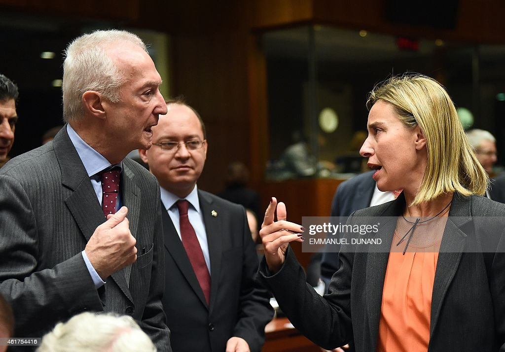 EU counter-terrorism chief <a gi-track='captionPersonalityLinkClicked' href=/galleries/search?phrase=Gilles+de+Kerchove&family=editorial&specificpeople=4505334 ng-click='$event.stopPropagation()'>Gilles de Kerchove</a> (L) speaks with EU foreign policy chief <a gi-track='captionPersonalityLinkClicked' href=/galleries/search?phrase=Federica+Mogherini&family=editorial&specificpeople=7400570 ng-click='$event.stopPropagation()'>Federica Mogherini</a> (R) on January 19, 2015 during a EU Foreign Affairs Council meeting at EU headquarters in Brussels. EU foreign ministers are to discuss ways to boost anti-terror cooperation in the wake of the Paris attacks and the dismantling of a jihadist cell in Belgium.