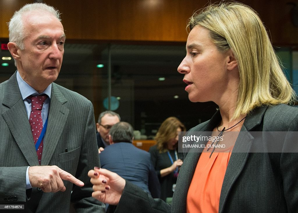 EU counter-terrorism chief <a gi-track='captionPersonalityLinkClicked' href=/galleries/search?phrase=Gilles+de+Kerchove&family=editorial&specificpeople=4505334 ng-click='$event.stopPropagation()'>Gilles de Kerchove</a> (L) speaks with EU foreign policy chief <a gi-track='captionPersonalityLinkClicked' href=/galleries/search?phrase=Federica+Mogherini&family=editorial&specificpeople=7400570 ng-click='$event.stopPropagation()'>Federica Mogherini</a> on January 19, 2015 before the start of a EU Foreign Affairs Council meeting at EU headquarters in Brussels. EU foreign ministers are to discuss ways to boost anti-terror cooperation in the wake of the Paris attacks and the dismantling of a jihadist cell in Belgium.