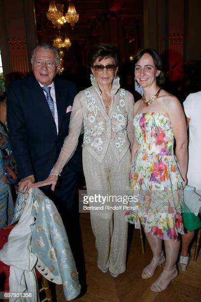 Countess Jacqueline de Ribes standing between her son Count Jean de Ribes and guest attend the 'Societe ses Amis du Musee d'Orsay' Dinner Party at...