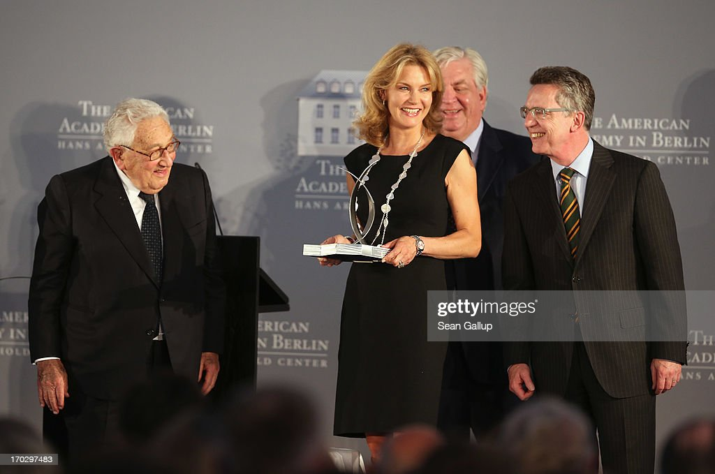 Countess Vera de Lesseps accepts the Henry A. Kissinger Prize on behalf of her late father, Ewald-Heinrich von Kleist, as former U.S. Secretary of State <a gi-track='captionPersonalityLinkClicked' href=/galleries/search?phrase=Henry+Kissinger&family=editorial&specificpeople=154883 ng-click='$event.stopPropagation()'>Henry Kissinger</a> (L), American Academy in Berlin President A. Michael Hoffman and German Defence Minister <a gi-track='captionPersonalityLinkClicked' href=/galleries/search?phrase=Thomas+de+Maiziere&family=editorial&specificpeople=618845 ng-click='$event.stopPropagation()'>Thomas de Maiziere</a> look on at the Henry A. Kissinger Prize 2013 award at the American Academy in Berlin on June 10, 2013 in Berlin, Germany.