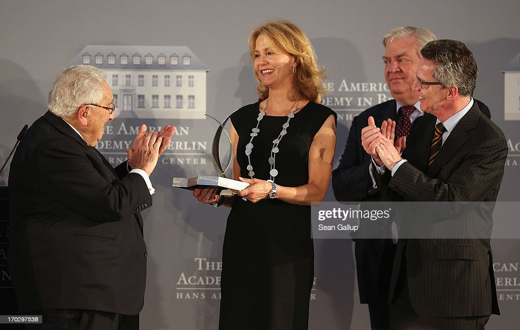 Countess Vera de Lesseps accepts the Henry A. Kissinger Prize on behalf of her late father, Ewald-Heinrich von Kleist, as former U.S. Secretary of State <a gi-track='captionPersonalityLinkClicked' href=/galleries/search?phrase=Henry+Kissinger&family=editorial&specificpeople=154883 ng-click='$event.stopPropagation()'>Henry Kissinger</a> (L), American Academy in Berlin President A. Michael Hoffman and German Defence Minister <a gi-track='captionPersonalityLinkClicked' href=/galleries/search?phrase=Thomas+de+Maiziere&family=editorial&specificpeople=618845 ng-click='$event.stopPropagation()'>Thomas de Maiziere</a> (R) look on at the Henry A. Kissinger Prize 2013 award at the American Academy in Berlin on June 10, 2013 in Berlin, Germany.