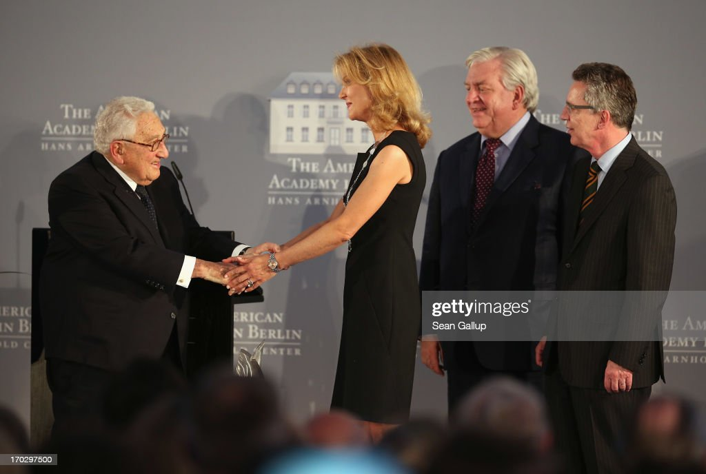 Countess Vera de Lesseps shakes the hands of former U.S. Secretary of State <a gi-track='captionPersonalityLinkClicked' href=/galleries/search?phrase=Henry+Kissinger&family=editorial&specificpeople=154883 ng-click='$event.stopPropagation()'>Henry Kissinger</a> (L) before accepting the Henry A. Kissinger Prize on behalf of her late father, Ewald-Heinrich von Kleist, as American Academy in Berlin President A. Michael Hoffman and German Defence Minister <a gi-track='captionPersonalityLinkClicked' href=/galleries/search?phrase=Thomas+de+Maiziere&family=editorial&specificpeople=618845 ng-click='$event.stopPropagation()'>Thomas de Maiziere</a> (R) look on at the Henry A. Kissinger Prize 2013 award at the American Academy in Berlin on June 10, 2013 in Berlin, Germany.