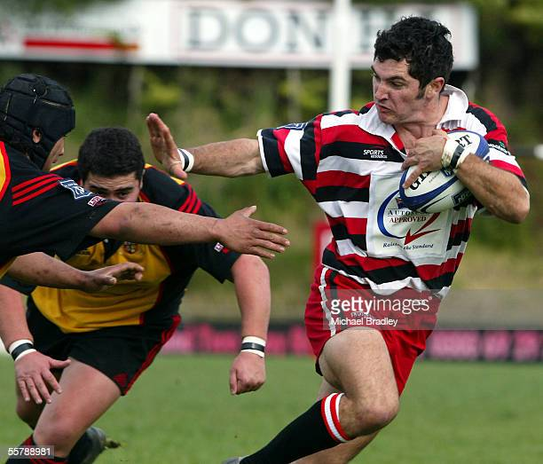 Counties Stephen Donald looks to fend off the tackle as he heads to the try line during the second division NPC rugby match between Counties Manukau...