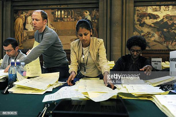 Counting officials sort voting papers in Manchester Town Hall northwest England on June 07 2009 The city is hosting the count for the north west of...