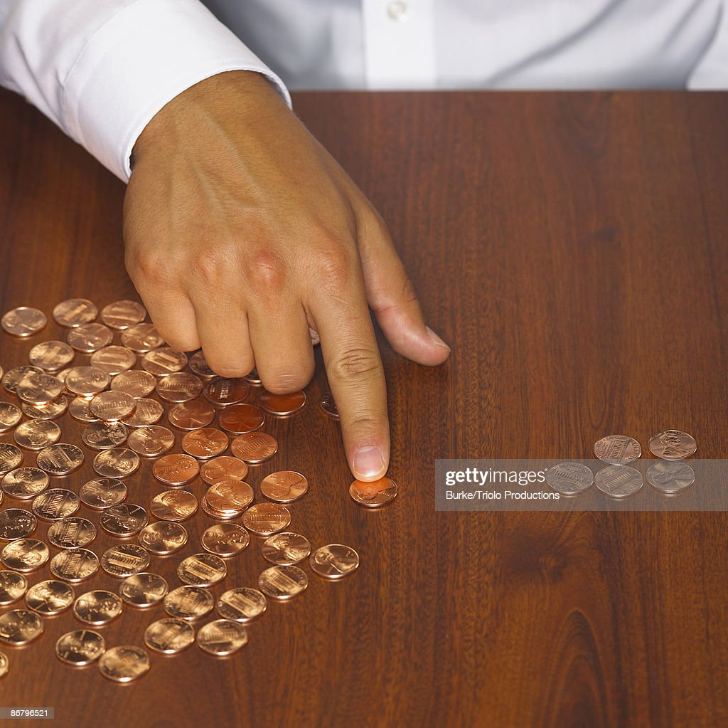 Counting pennies : Stock Photo