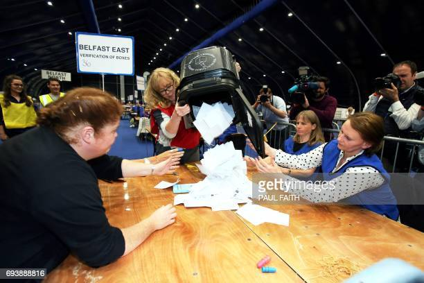 Counting staff carry the first ballot boxes as they arrive at a counting centre in Titanic Exhibition in Belfast Northern Ireland on June 8 after the...