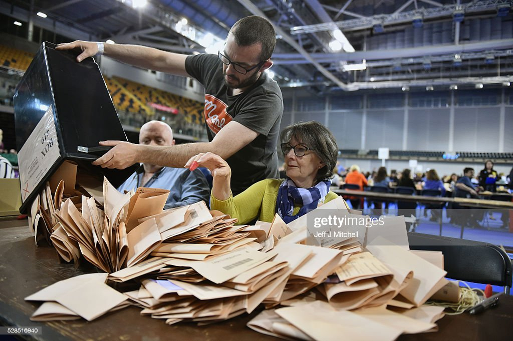 Counting staff check ballot papers in the Scottish Parliament elections at the Emirates Arena on May 5, 2016 in Glasgow, Scotland. The first declarations are expected at about 02:00 on Friday, with the final result at about 08:00 opinion polls ahead of the vote suggested the SNP was on course to win a third successive victory.