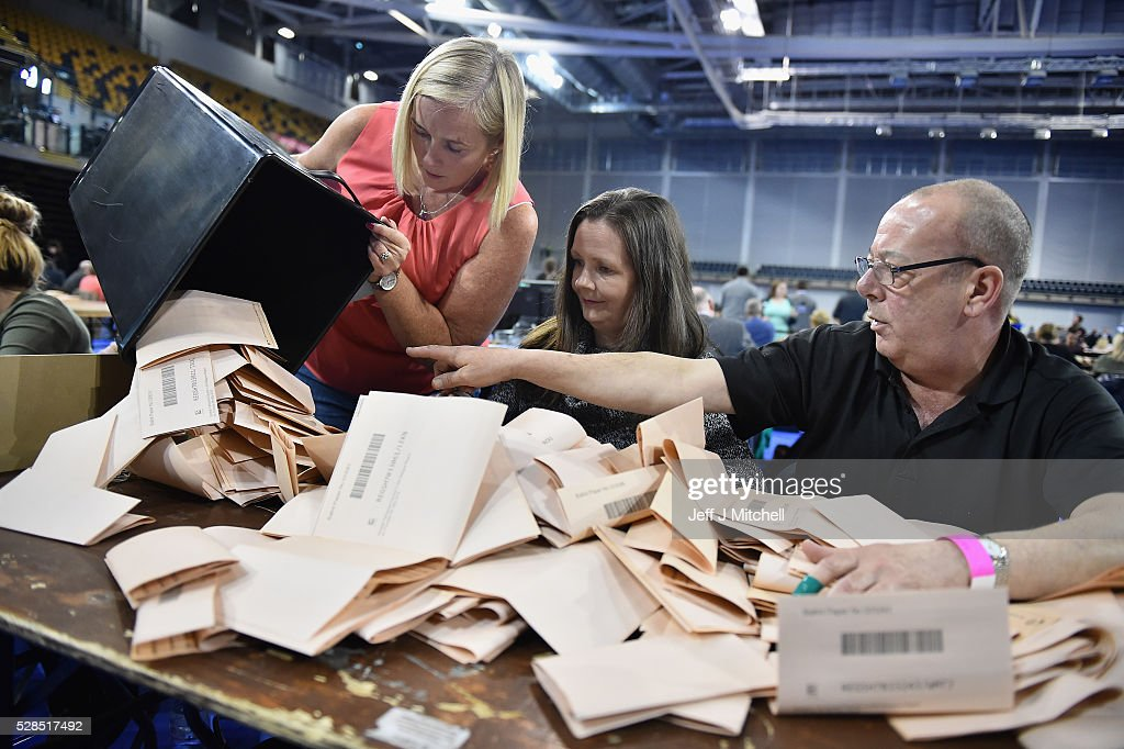 Counting staff check ballot papers in the Scottish Parliament elections at the Emirates Arena on May 5, 2016 in Glasgow,Scotland. The first declarations are expected at about 02:00 on Friday, with the final result at about 08:00 opinion polls ahead of the vote suggested the SNP was on course to win a third successive victory.