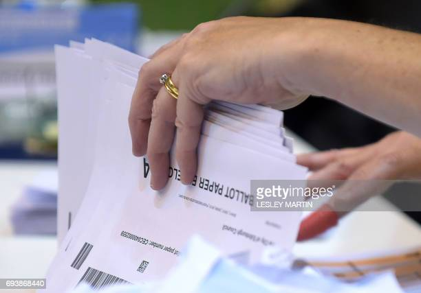 A counting staff member sorts ballots from postal votes at the Meadowbank Sports Centre counting centre in Edinburgh Scotland on June 8 as Britain...