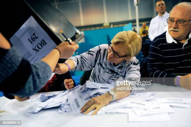 Counting staff members empty the first ballot boxes at the main Glasgow counting centre in Emirates Arena in Glasgow Scotland on June 8 after the...