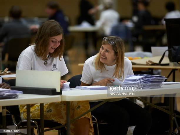 Counting staff sort through ballots at a counting centre in Islington London on June 8 after the polls closed in Britain's general election Prime...
