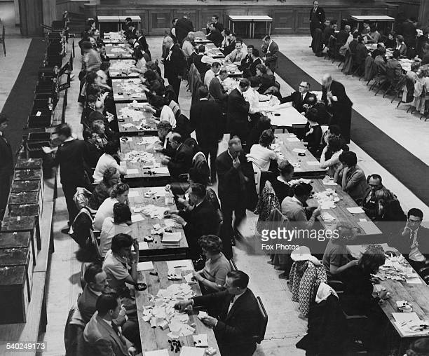 Counting votes for the General Election Walthamstow Assembly Hall London 1964