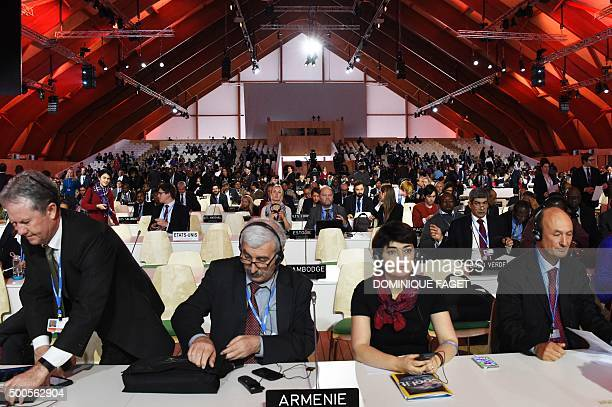 Countries' delegates attend a plenary a session at the COP21 United Nations climate change conference in Le Bourget outside Paris on December 9 2015...
