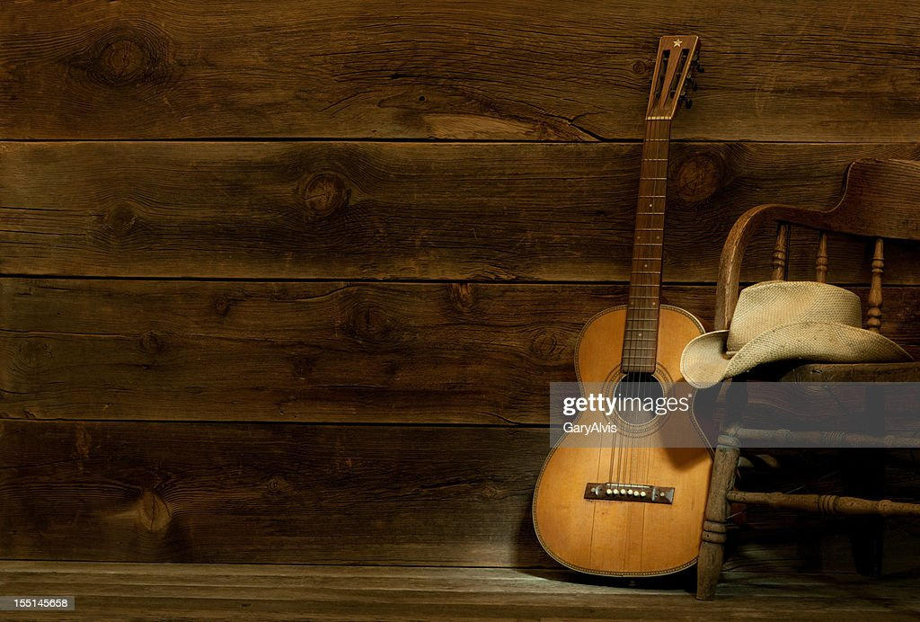Country and Western Music scene w/chair,hat,guitar-barnwood background : Stock Photo