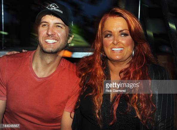 Country Artist Luke Bryan and Grammy award winner Wynonna Judd backstage during the GRAMMY Block Party at Owen Bradley Park on May 8 2012 in...
