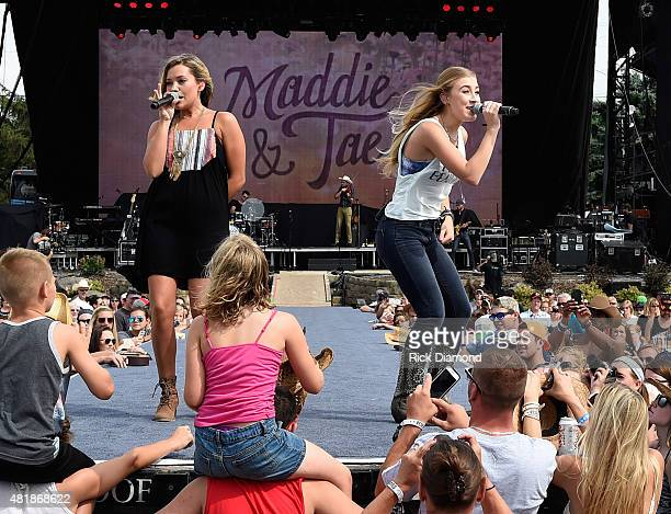 Country Duo Maddie Tae L/R Tae Dye and Maddie Marlow perform at Country Thunder In Twin Lakes Wisconsin Day 2 on July 24 2015 in Twin Lakes Wisconsin