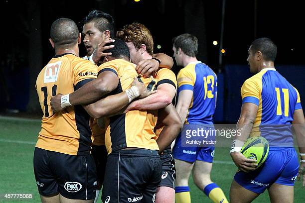Country Eagles celebrate a try with Matt Feaunati of Brisbane City looking dejected during the NRC Semi Final match between NSW Country and Brisbane...