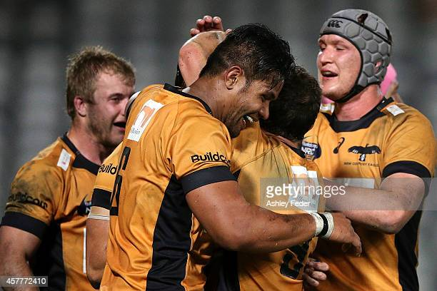 Country Eagles players celebrate a try during the NRC Semi Final match between NSW Country and Brisbane City at Central Coast Stadium on October 24...