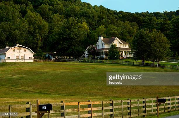 Country Farm with White Barn and White House or Home