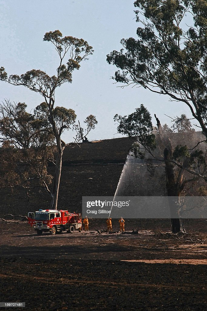Country Fire Authority extinguish spot fires near the town of Seaton on January 19, 2013 in Australia. Bushfires in Victoria have claimed one life and destroyed several houses as record heat continues to create extreme fire conditions throughout Australia.
