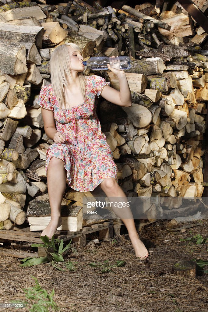 Country girl drinking : Stock Photo