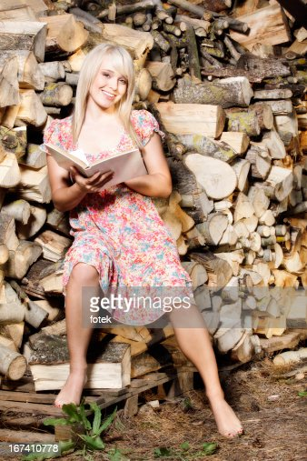 Country girl reading a book : Stock Photo