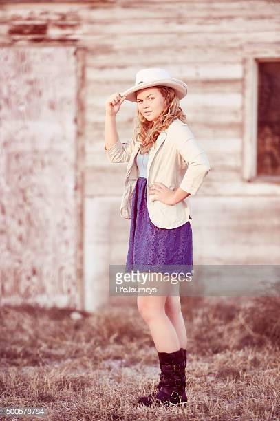 Country Girl With Boots and Hat At The Barn