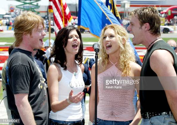 Country group Little Big Town sings the National Anthem during the CarQuest Auto Parts 300 prerace