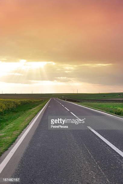 Country highway and dramatic evening sky.